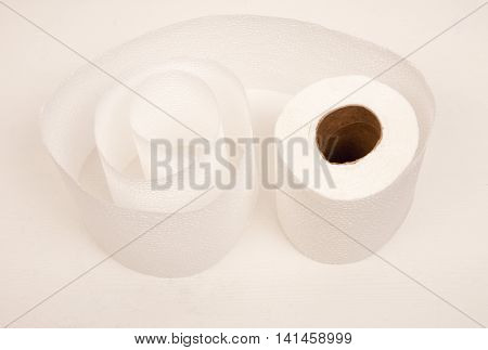 White toilet paper twisted into a spiral.