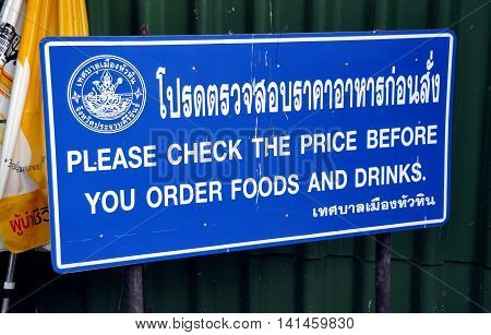 Hua Hin Thailand - December 29 2009: Sign at the entrance to the Hua Hin Beach advises people to check the prices on food and drinks sold by vendors before they buy