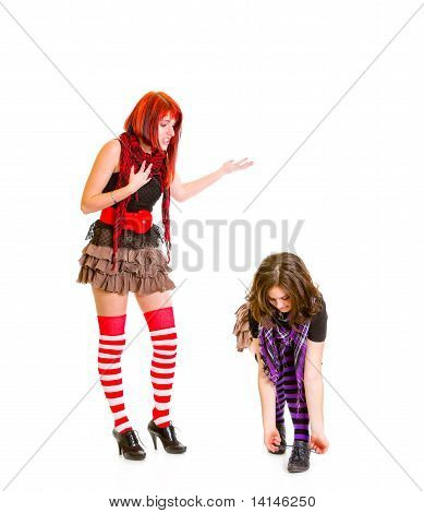 Girl trying to talk with not listening her tying shoelaces girlfriend isolated on white
