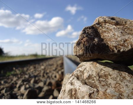 Upclose photo of rocks placed on a rail track.