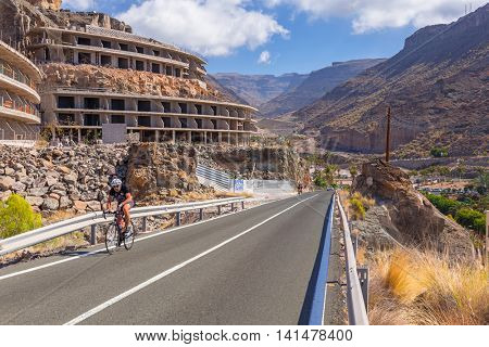 GRAN CANARIA, SPAIN - APRIL 23, 2016: Unidentified cyclist on the mountain road of Gran Canaria. Gran Canaria is the second most populous island of the Canary Islands