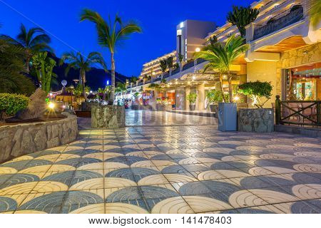 TAURITO, GRAN CANARIA, SPAIN - APRIL 22, 2016: Beach and resort complex in Taurito at night, Gran Canaria island, Spain. Taurito is very popular tourist destination on Gran Canaria.