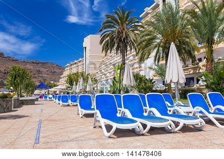 TAURITO, GRAN CANARIA, SPAIN - APRIL 22, 2016: Sun holidays at the pool of Paradise Lago Taurito hotel, Gran Canaria. Paradise is a complex of 4 hotels in Gran Canaria.