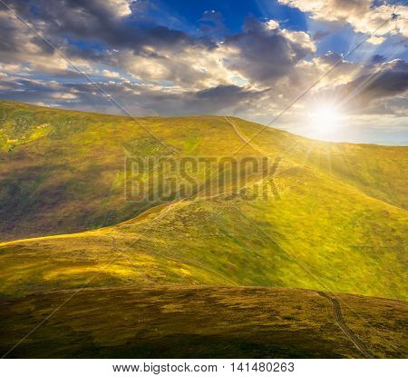 Road Through A Meadow On Hillside At Sunset