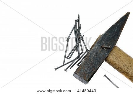 Close Up Of A Hammer Head And Nails On White Background