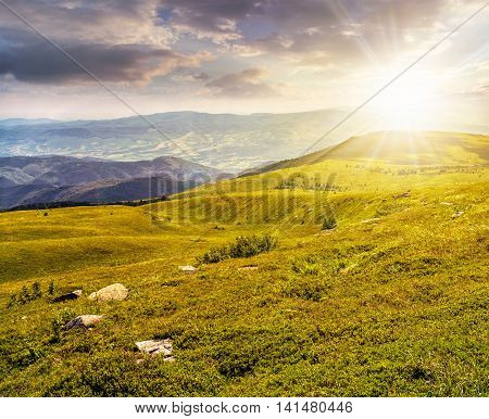 Stones On The Hill Of Mountain Range At Sunset