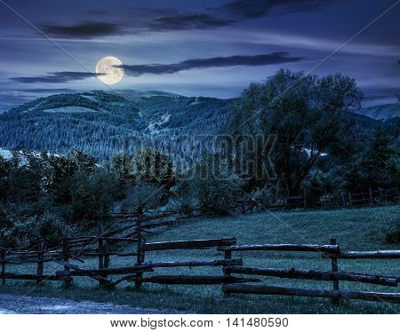 Wooden Fence On Hillside At Night