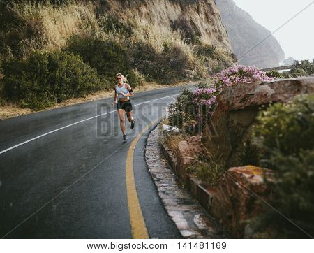 Fitness Woman Running Outdoors On Highway