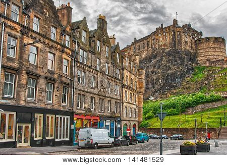 Edinburgh, UK - May 11, 2011: Edinburgh Castle on the hill view from street in Edinburgh in Scotland. It is the capital of Scotland in the United Kingdom.
