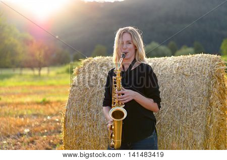 Female Musician Playing A Tenor Saxophone