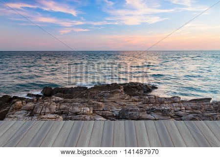 Opening wooden floor, Beautiful natural landscape background, sky and clouds over seacoast after sunset