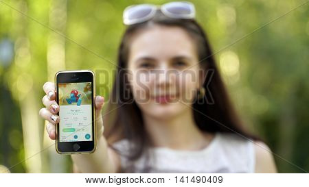 Samara, Russia - August 6, 2016: woman playing pokemon go on his iphone. pokemon go multiplayer game with elements of augmented reality. Catching the Porygon pokemon.