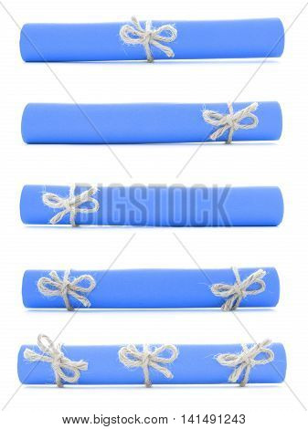 Blue paper rolls tied with handmade cords and bows isolated
