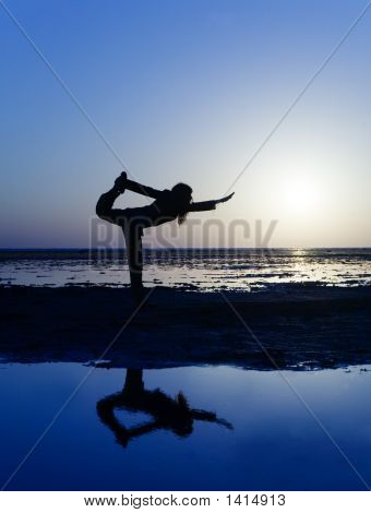 Stretching On The Beach