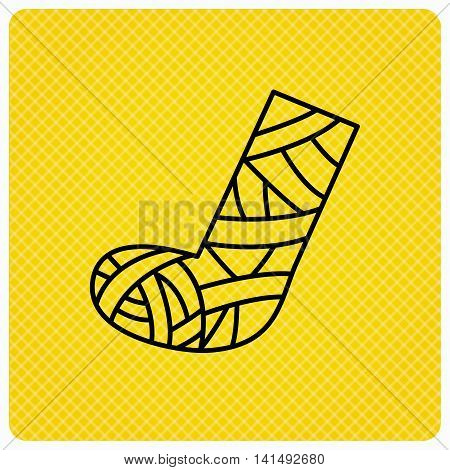 Gypsum or cast foot icon. Broken leg sign. Human recovery medicine symbol. Linear icon on orange background. Vector