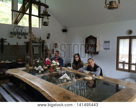 Romania, August 20, 2015, Romania, August 2015, Gura-Teghii, Moldova,  Mountains Bed&breakfast - People having lunch in the  kitchen