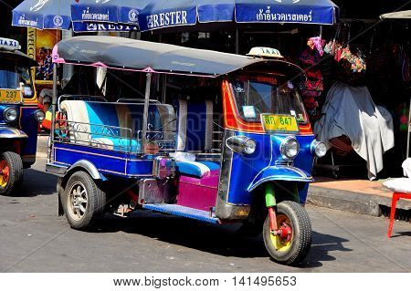 Bangkok Thailand - January 19 2013: Three wheeled tuk-tuk taxi cruising along touristy Khao San Road seeking a fare *
