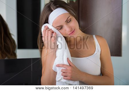 Woman Drying Her Face With A Towel