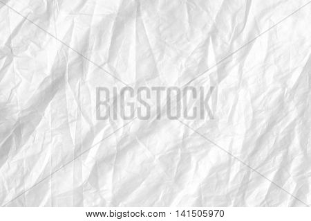 Abstract white creased paper background texture .