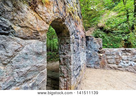 Abandoned stone castle house archway at Wildwood Trail in Forest Park Portland Oregon
