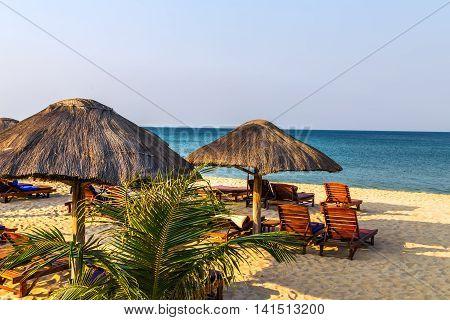 Beach Lounge Chairs Under Tent On Beach