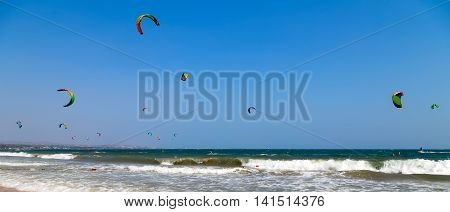 Kite Surfer Ridings in sea wave, kite rider making a high jump