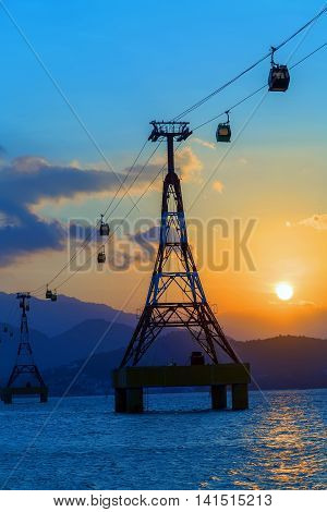 Sea sunset the cable car over sea leading to Vinpearl Park Nha Trang Vietnam.