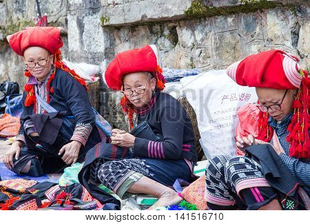 TA PHIN LAO CAI VIETNAM - NOV 21 2014: Woman from Red Dao minority group wearing traditional headdress near Ban Ho village Sapa District Lao Cai Vietnam.