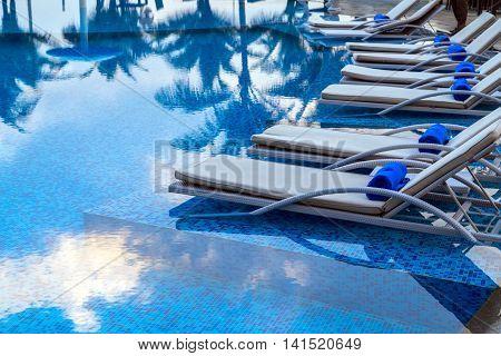 Sunbeds Beside Swimming Pool