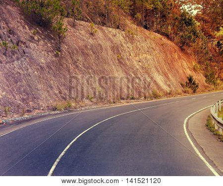 Sunshine Asphalt Road In Mountain