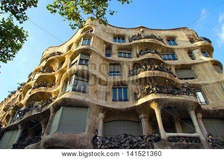 BARCELONA - AUGUST 24: Casa Mila or La Pedrera on August 24 2012 in Barcelona Spain. This famous building was designed by Antoni Gaudi. Vintage retro style