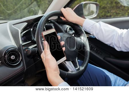 Businessman Checking Phone While Careless Driving - Distraction And Bad Habit Driving Concept