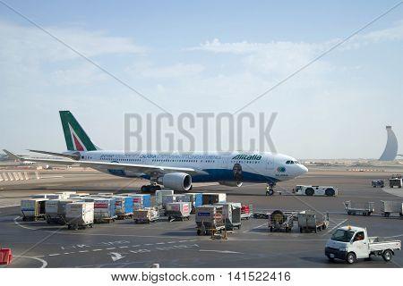 ABU DHABI, UAE - MARCH 27, 2015: The Airbus A330 - MSN 1123 (EI-EJG) Alitalia on the apron of airport Abu Dhabi