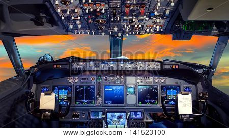 airplane cockpit Flight Deck in sunset travel transport aircraft