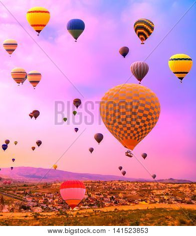 Hot Air balloons flying over Sunset Mountains landscape sunset Cappadocia Turkey