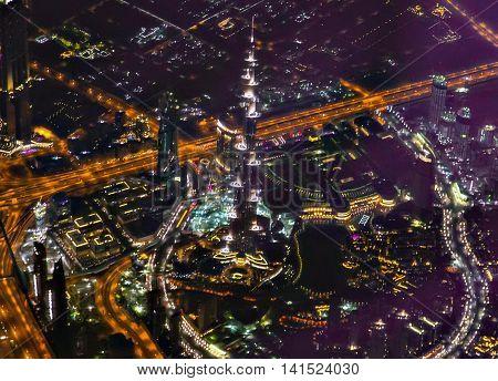 DUBAI UAE - JANUARY 26 2016: Top Burj Khalifa in night Khalifa Tower known as Burj Dubai before its inauguration is a megatall skyscraper in Dubai United Arab Emirates.