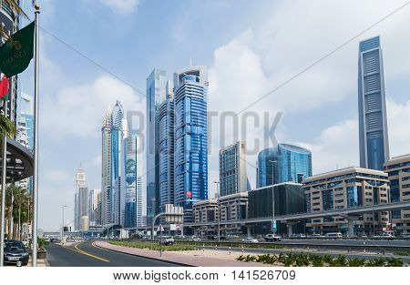 DUBAI UAE - JANUARY 26: Architecture of Dubai many highrise buildings. Dubai with many traditional arabic shops and street market. Dubai UAE circa January 2016
