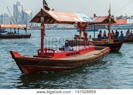 DUBAI UAE - JANUARY 23: Red boats Abra ferries on the Bay Creek in Dubaii UAE circa January 2016