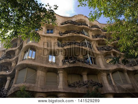 BARCELONA SPAIN - AUGUST 24: Casa Mila details of the facade of the house with tree made by the architect Antonio Gaudi on August 24 2012 in Barcelona Spain