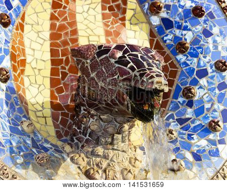 Sculpture of a snake of Antoni Gaudi mosaic in park guell of Barcelona