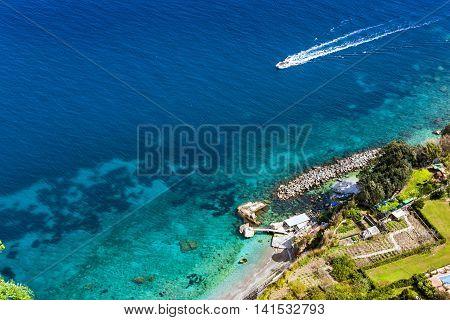 Boat Is Navigating On Capri Island Coast, Italy