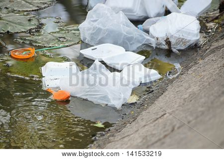 Garbage in the water / waste and garbage mismanagement concept