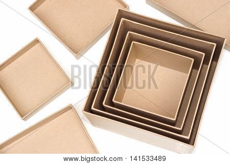Opened brown paper boxes in different sizes with lid isolated