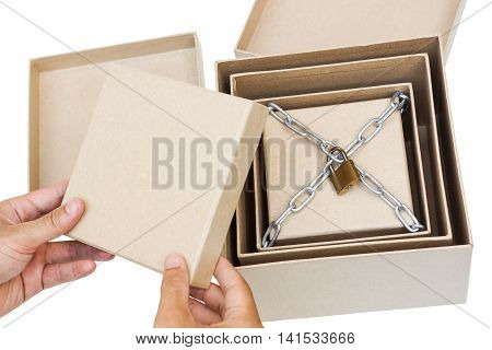 Hand opening secret boxes with the last one chained and lock / Secret and puzzle concept