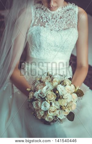 A bridal bouquet held by the bride