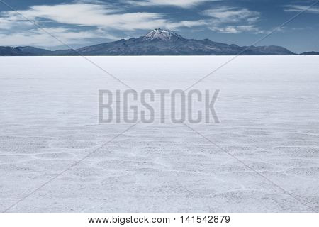 The world's largest salt flat and dormant volcano Tunupa at the far background, Salar de Uyuni, Bolivia