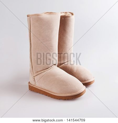Uggs  female Australian shoes in a grey background
