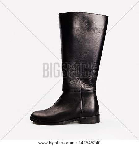 winter female black boots over white background