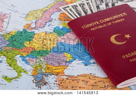 Passport With Hunded Dollar Banknotes On Map