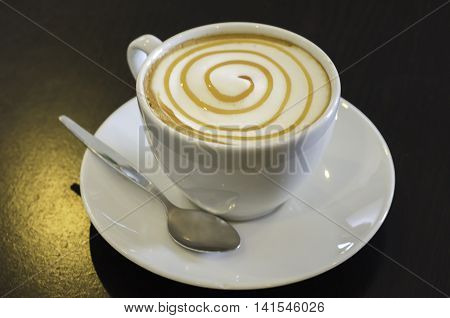 A cup of delicious hot cafe latte.